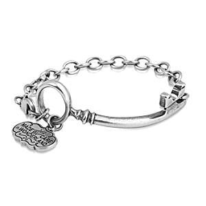Läs mer om Disney Couture Alice i Underlandet vitguldspläterat armband med nyckel